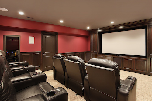 Theater in luxury home with red walls, video installation